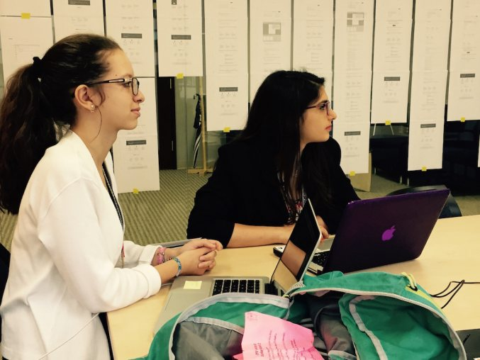 Photo of two young women with laptops