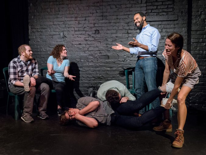 Six company members of the Washington Improv Theater perform an improvised scene.