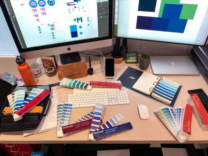 The very Pantone-covered desk of our creative director, Neal.